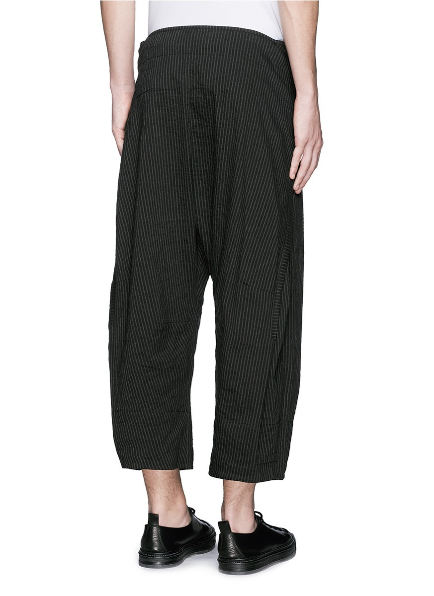 Wide leg trouser in light, crisp poplin with flat pleating from the waist. Zip fly with hook-tab and button closure, seamed waist. Slant side pockets. Tonal stitching. Machine wash cold, do not tumble dry.