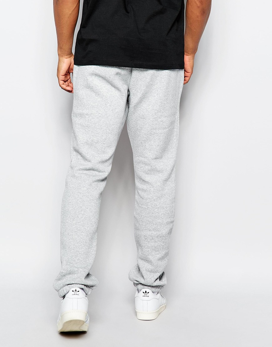adidas originals track pants in gray for men lyst