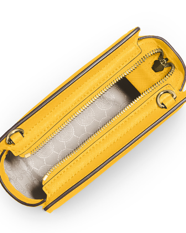 09216ff25578 wholesale lyst michael michael kors selma mini saffiano messenger bag in  yellow 142a9 af21d