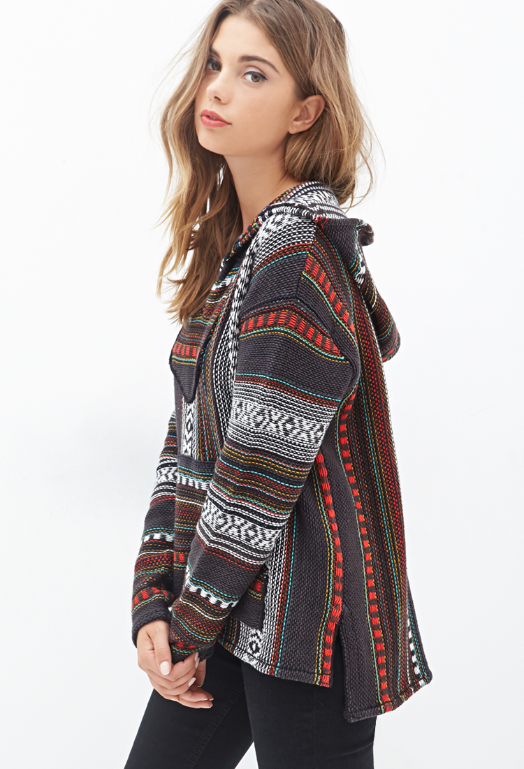 Billabong Baja Beach 2 hoodie. Poncho-inspired knit hoodie with an allover stripe jacquard design. Lace up detail at the neck. Billabong label on the kangaroo hand pocket.