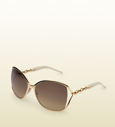 Gucci Gold Chain Chain Sunglasses in Gold