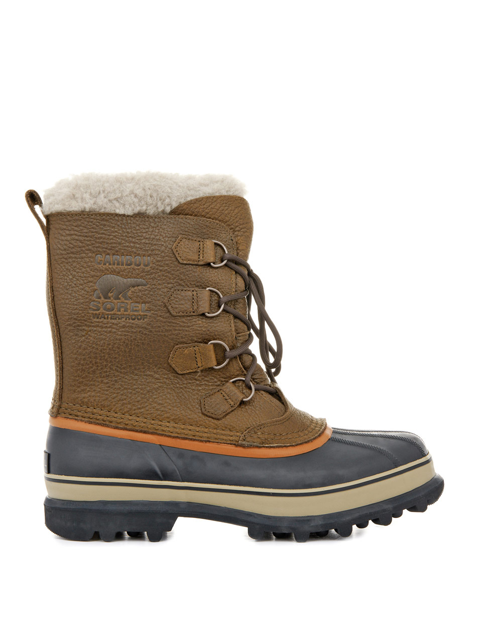 sorel caribou leather and rubber boots in brown for lyst