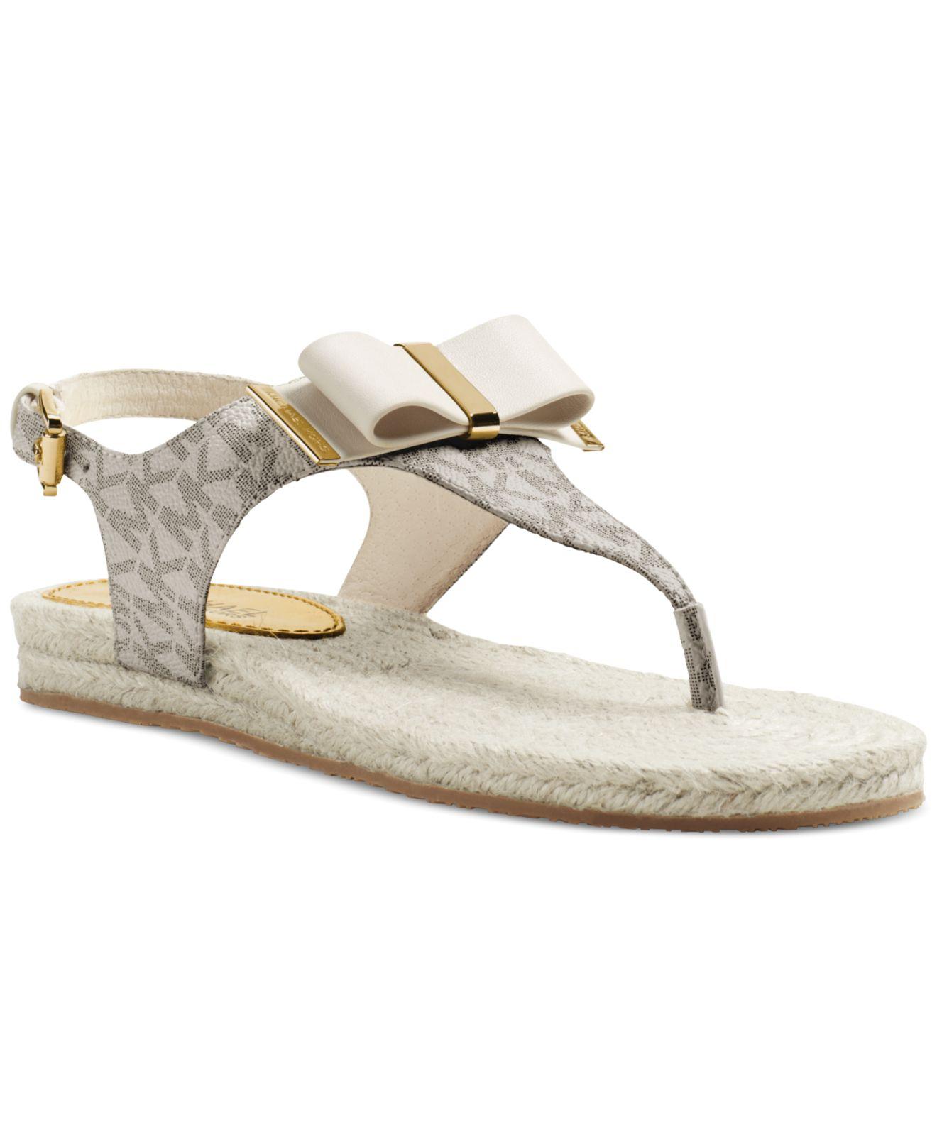 Lyst Michael Kors Michael Meg Thong Flat Sandals In Natural