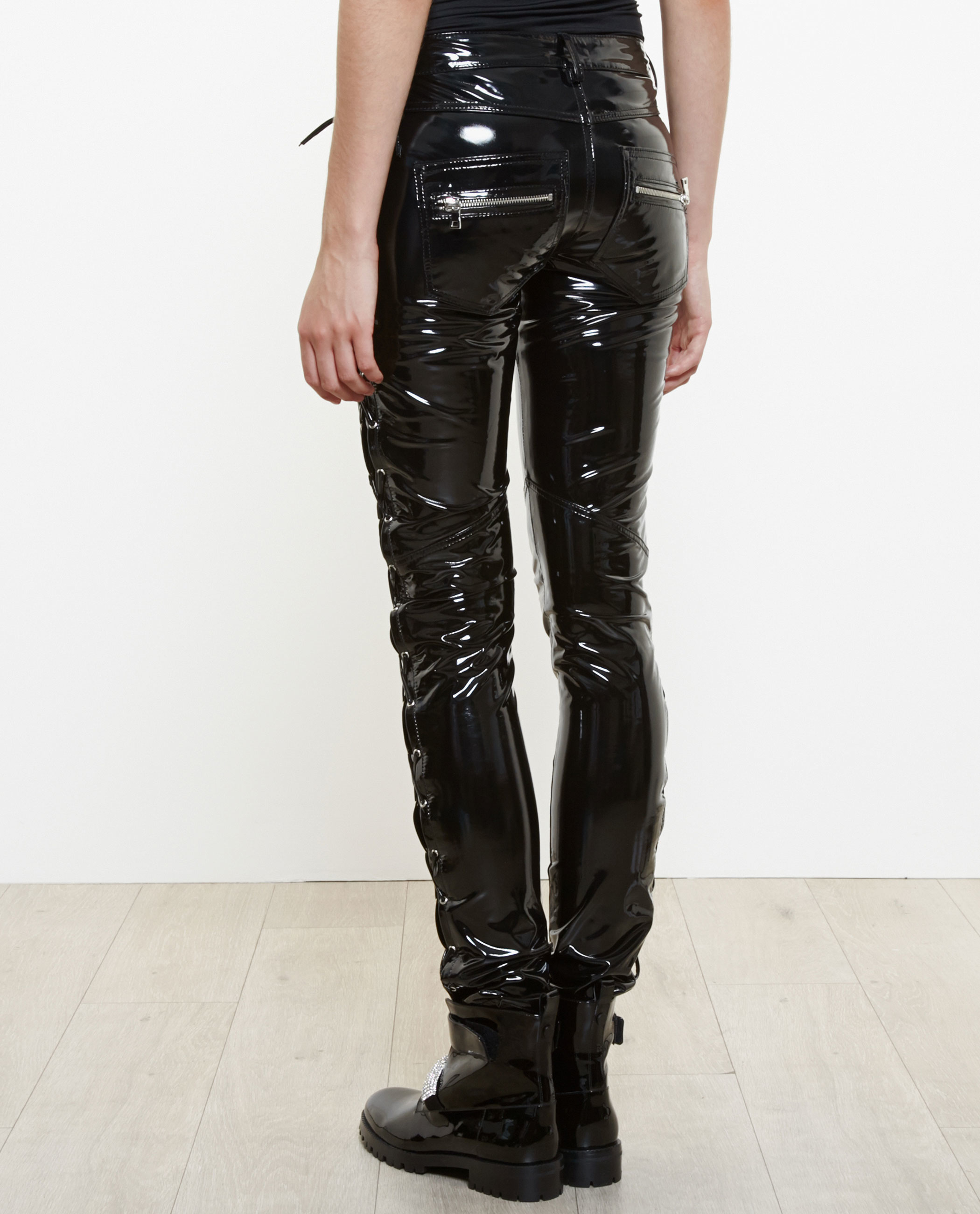 The English television and radio personality Zoë Ball wore black PVC pants in one of her appearances on English TV program called Shooting Stars. In certain episodes of the American television series called Smallville the actress Erica Durance appears wearing PVC clothes.
