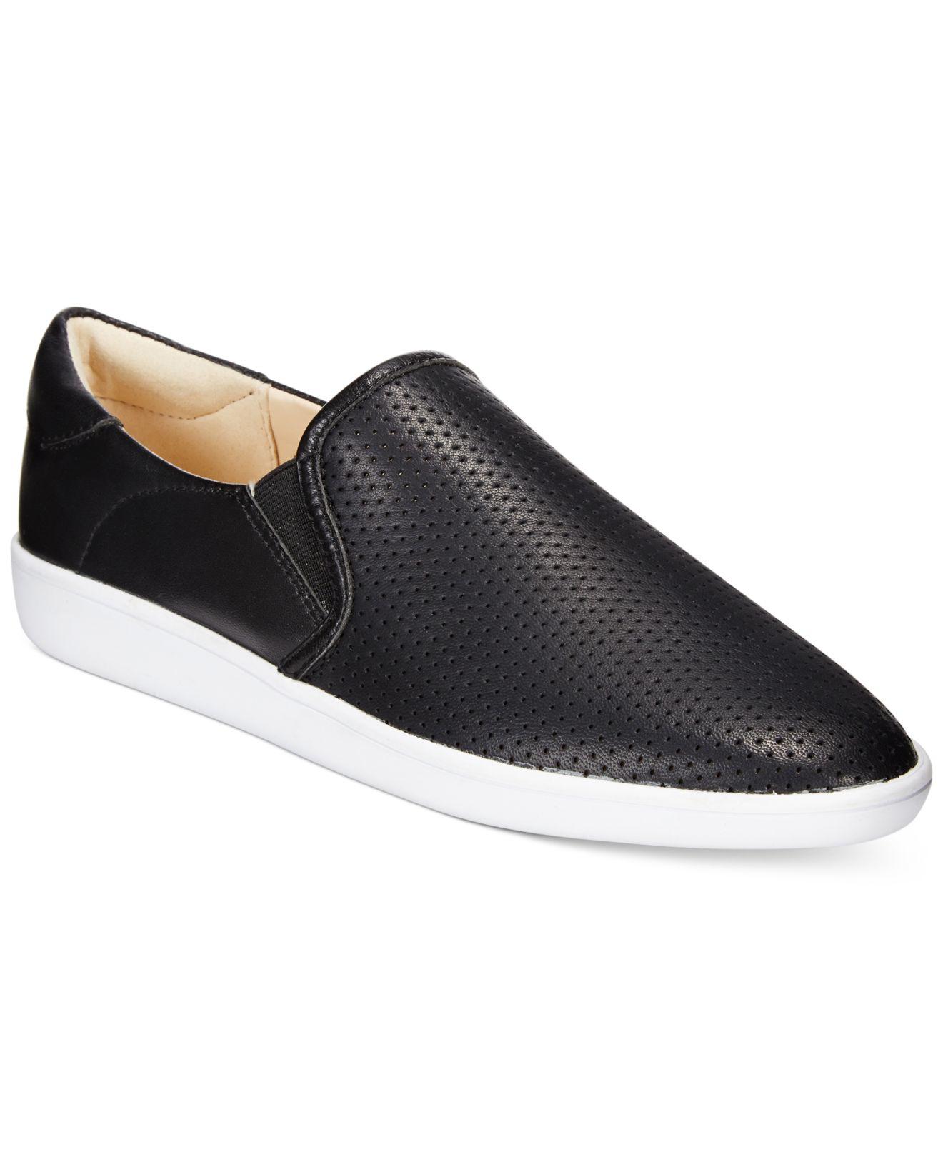 nine west lildevil perforated slip on sneakers in black lyst