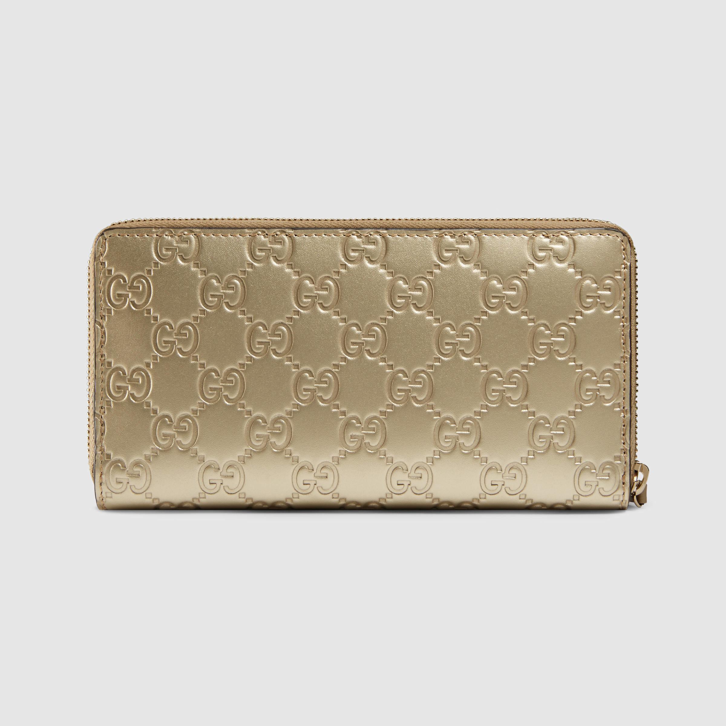 c255c0082d9d Gucci Bow Signature Zip Around Wallet in Metallic - Lyst