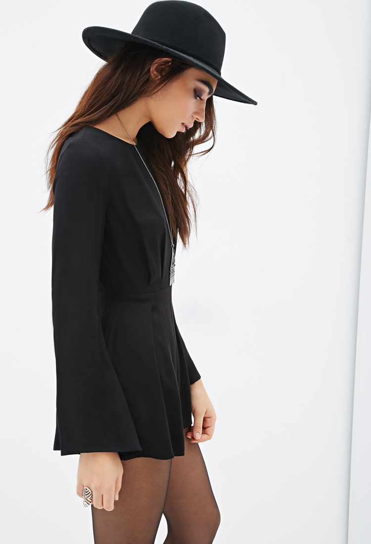 53aa06f9effc Lyst - Forever 21 Pleated Bell Sleeve Romper in Black