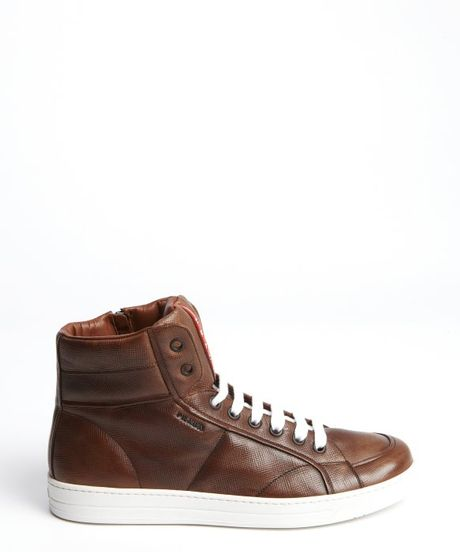 prada brown leather leather high top sneakers in brown for