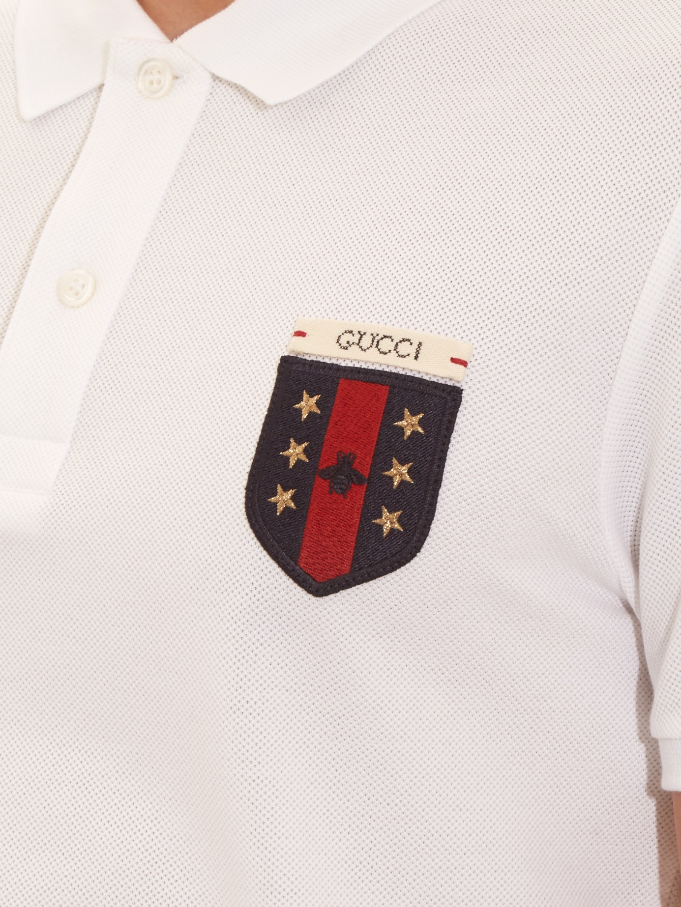 Gucci logo embroidered polo shirt in white for men lyst for Logo embroidered polo shirts