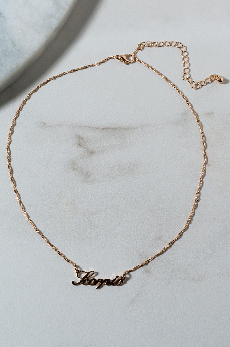 66a7cb95f7be5 Lyst - AKIRA Scorpio Nameplate Necklace in Metallic