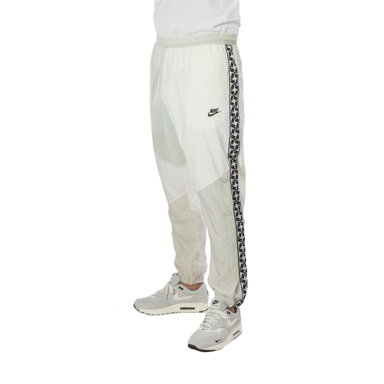 338f99a76e55 ... Nsw Taped Woven Pant for Men - Lyst. View fullscreen