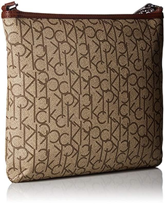 21f564fd2a Calvin Klein Hudson Signature Crossbody Flat Pack in Natural - Lyst