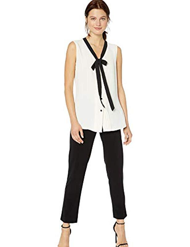 e5b382acd6921 Lyst - Anne Klein Sleeveless V-neck Bow Blouse in White - Save 72%