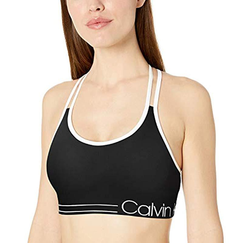 a645dda59d Lyst - Calvin Klein Ruched Front Strappy Sports Bra in Black - Save 26%