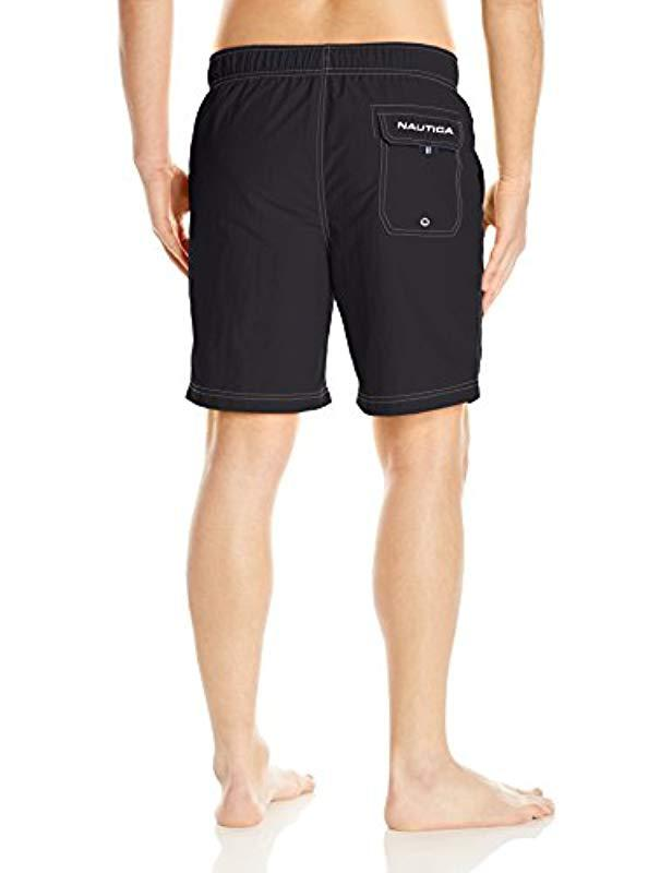 286740439a Lyst - Nautica Big And Tall Solid Quick Dry Classic Logo Swim Trunk in  Black for Men - Save 22%