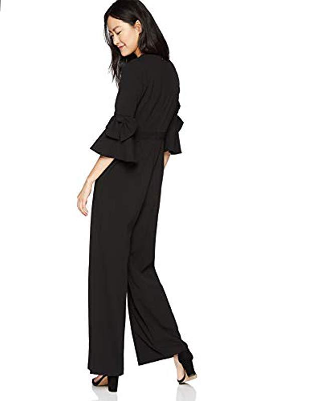 250185c1e0a25 Donna Morgan - Black V Neck Jumpsuit With Bell Sleeve - Lyst. View  fullscreen