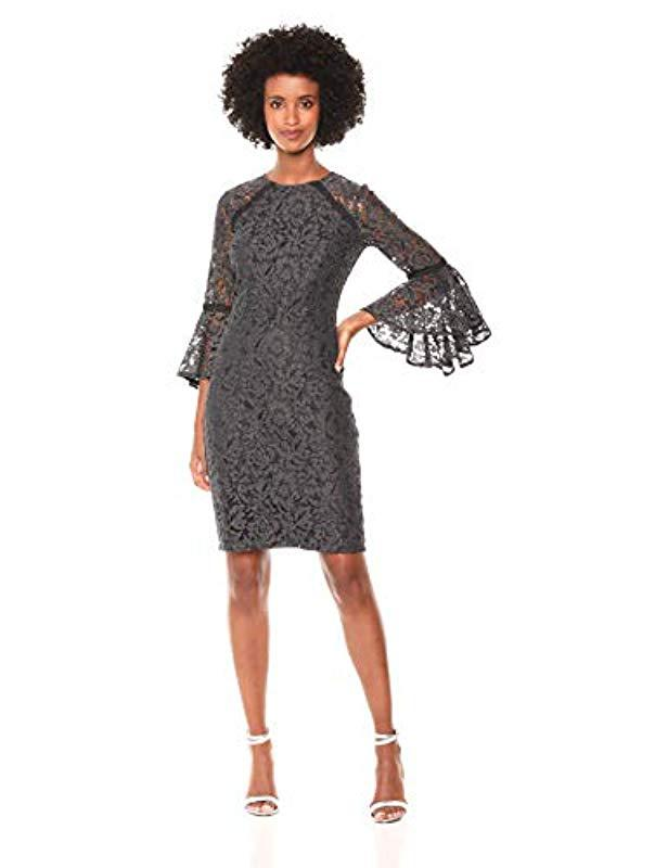 64b1c255c23b Lyst - Calvin Klein Lace Bell Sleeve Sheath Dress in Black