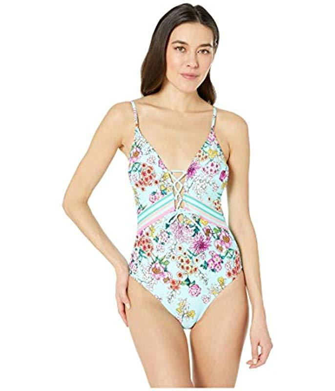 f35fa6989acc1 Kenneth Cole Reaction. Women's Blue Lace Front One Piece Swimsuit. $110  From Amazon Prime