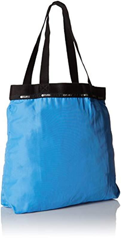 8ae667b0ea46 Lyst - Lesportsac Travel Simply Square Wallet in Blue - Save 35.0%