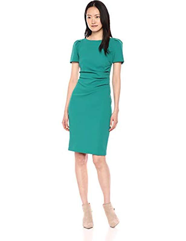 5f07adac1d Lyst - Calvin Klein Short Sleeve Sheath With Side Ruch Detail in Green