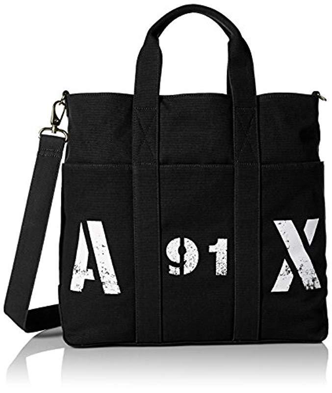 7f4edc52ef47 Armani Exchange. Men s Black Rmni Exchnge Printed X Logo Cnvs Tote With  Crossbody Strp