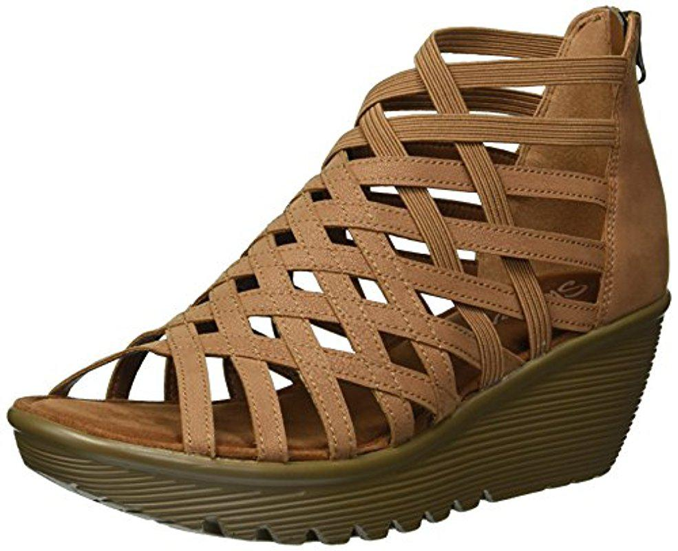 2d920e4e7af Lyst - Skechers Parallel-dream Queen Wedge Sandal in Brown