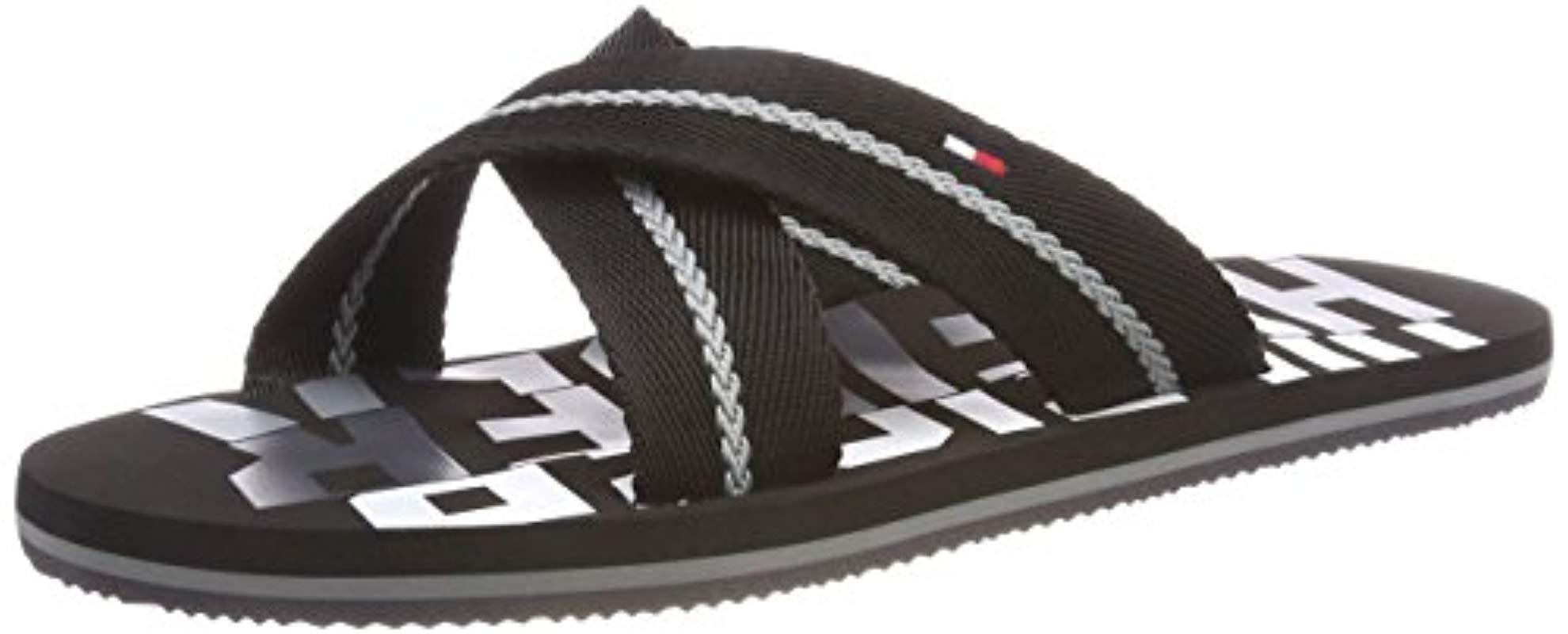 50a760069 Tommy Hilfiger - Black   s Bold Cross Beach Sandal Flip Flops for Men -