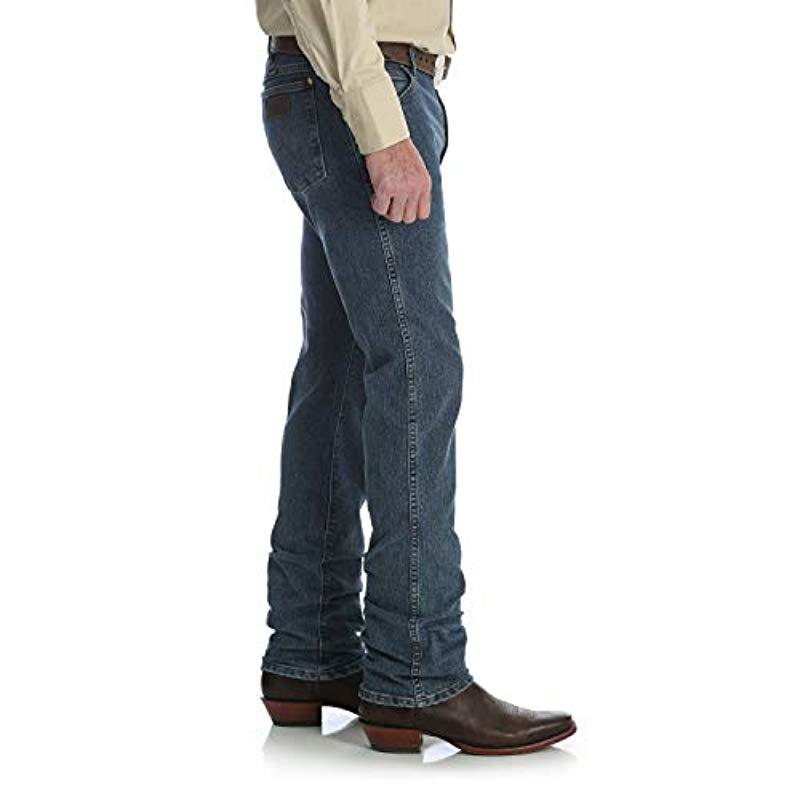 182b99d1 ... Premium Performance Cowboy Cut Comfort Wicking Slim Fit Jean for Men -  Lyst. View fullscreen