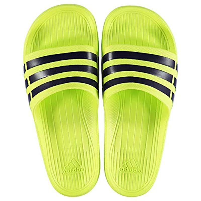 on sale beed7 16175 adidas. Black Duramo Slide, Unisex Adults Beach  Pool Shoes
