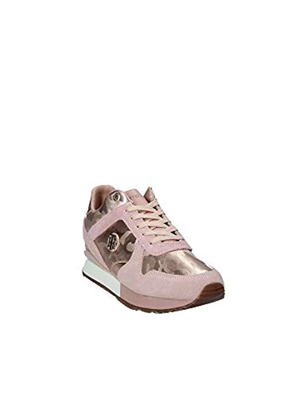 4b42ce0c34967 ... Tommy Hilfiger - Camo Metallic Wedge Sneaker Low-top - Lyst. Visit  Amazon. Tap to visit site