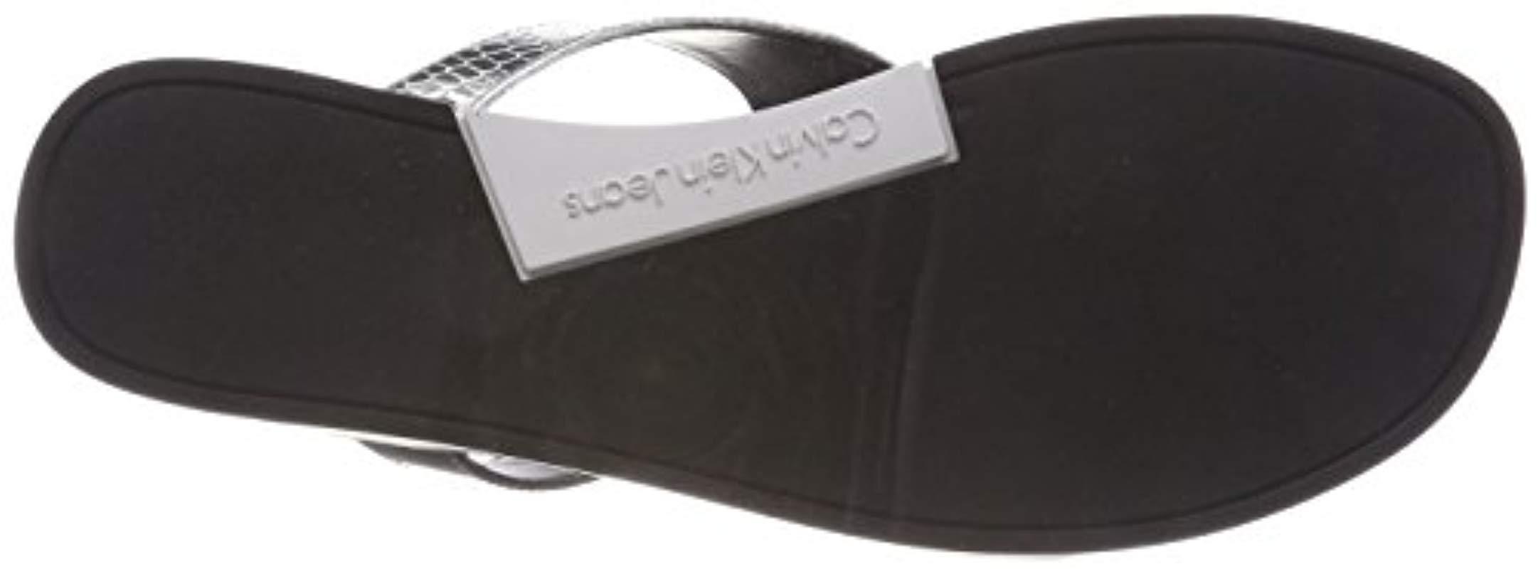 baa8b7c66a9 calvin-klein-Silver-Slv-000-Daphne-Metallic-Printed-Python-Flip-Flops.jpeg