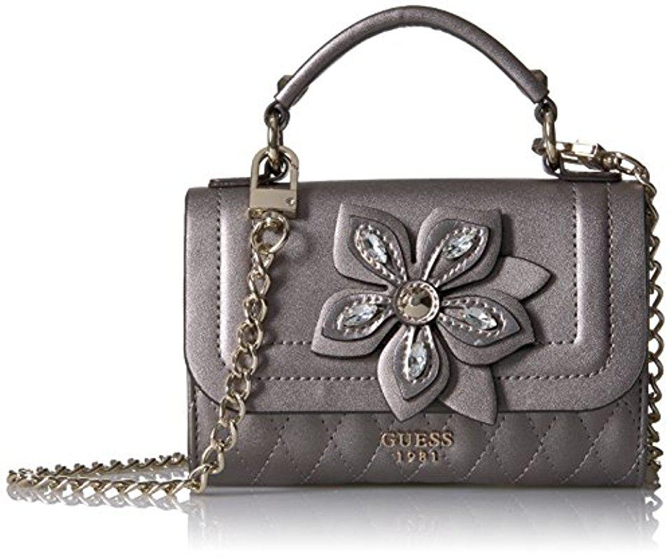 a56ff7ee86 Lyst - Guess Sibyl Metal Mini Crossbody Flap