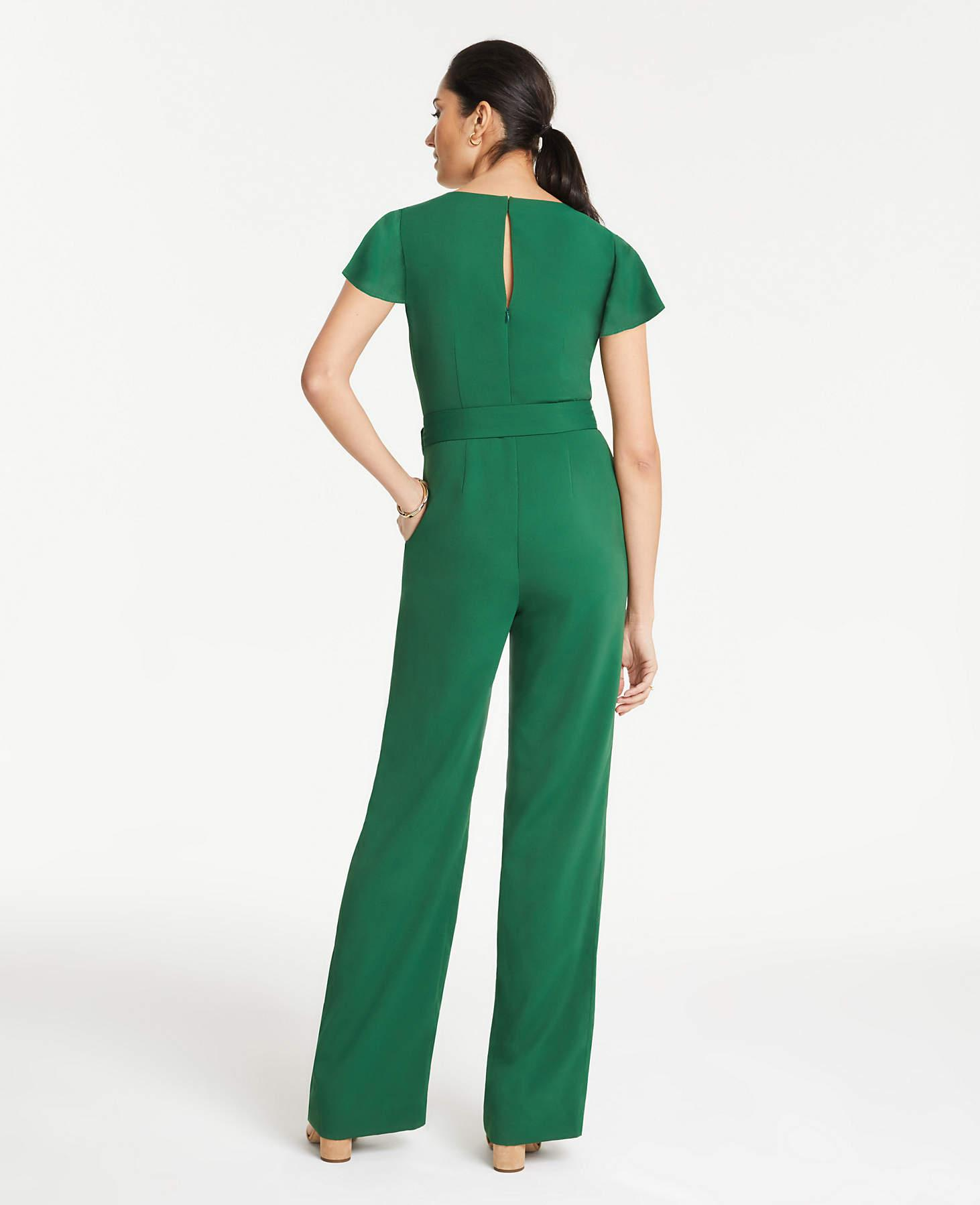 04c167e8e89 Ann Taylor Flutter Sleeve Wrap Jumpsuit in Green - Lyst