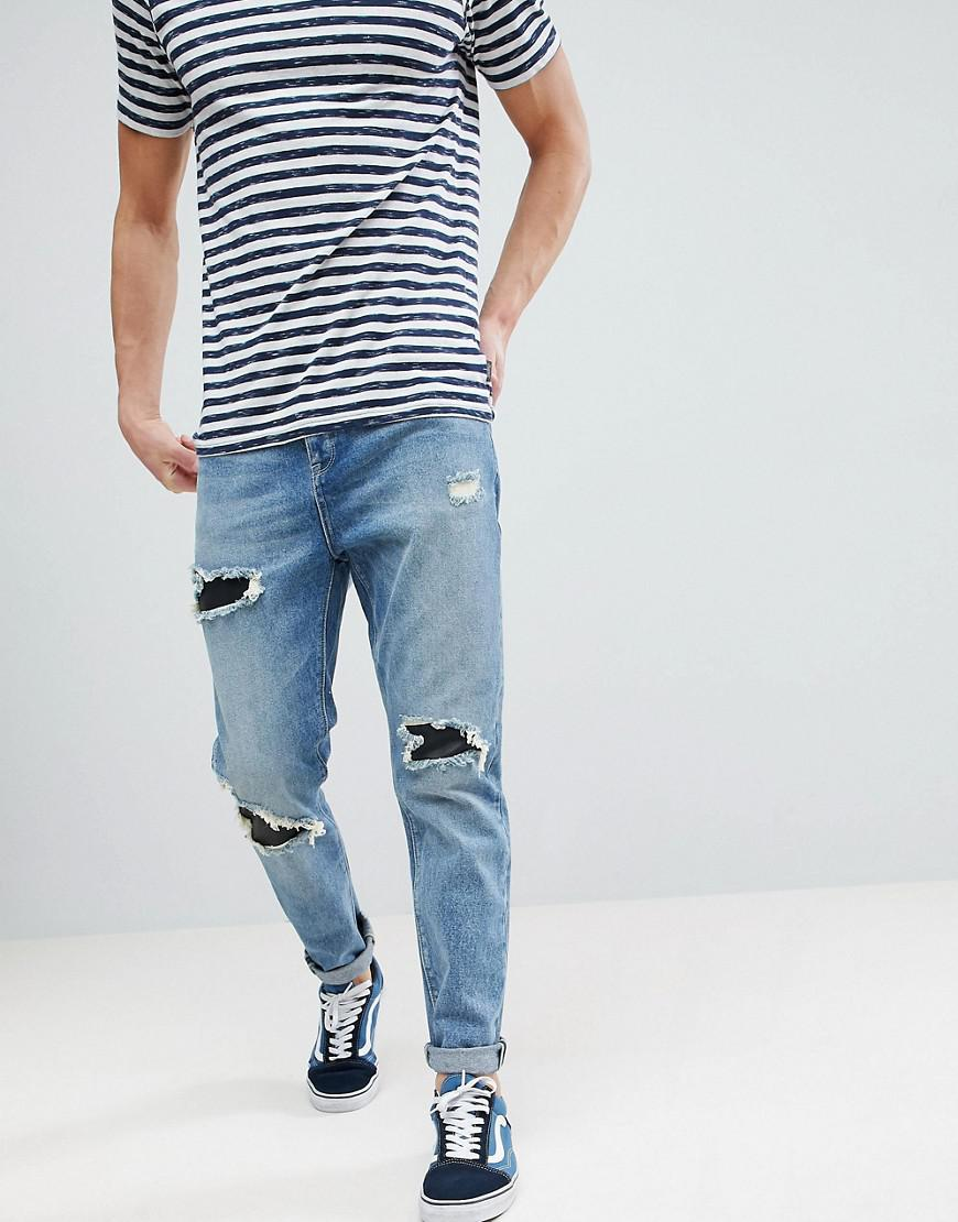 Tapered Jeans In Mid Wash Vintage With Faux Leather Rip & Repair - Mid wash vintage Asos