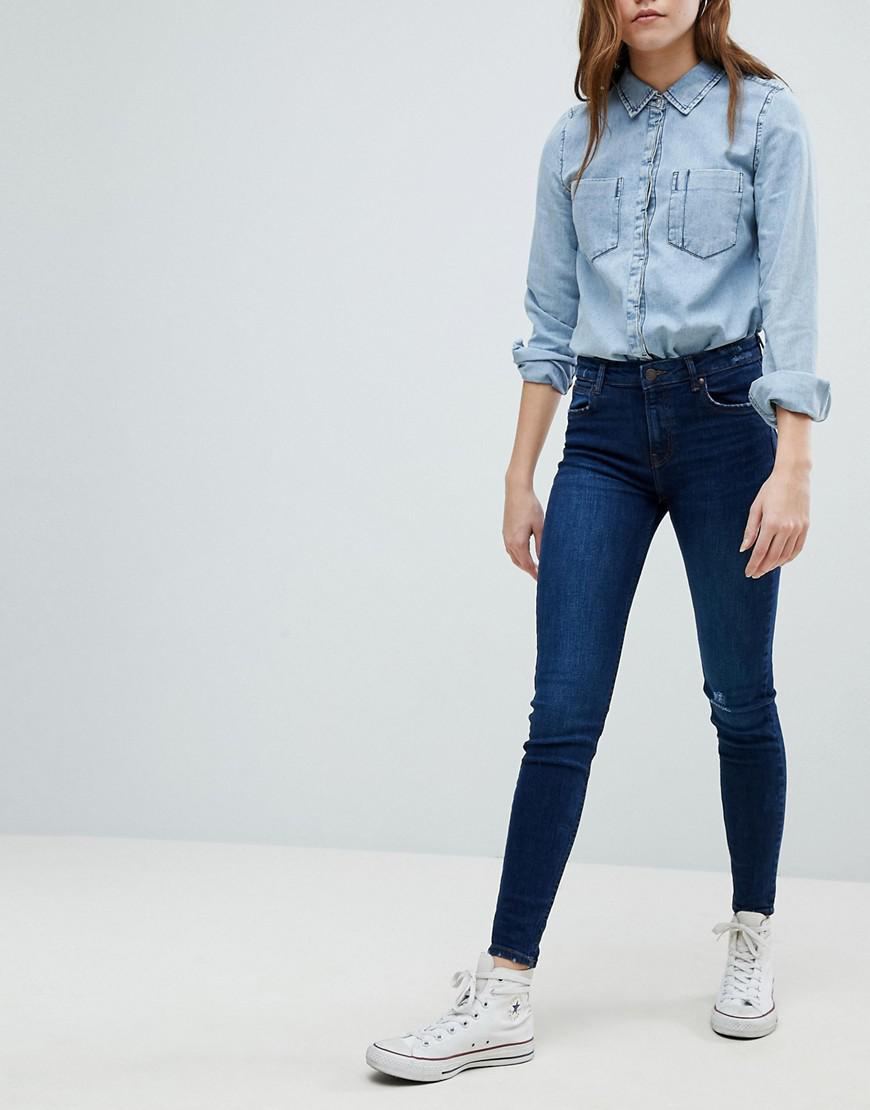lyst bershka worn knee skinny jeans in blue. Black Bedroom Furniture Sets. Home Design Ideas
