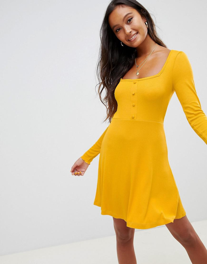 478e316d4a Lyst - ASOS Mini Skater Dress In Rib With Button Front in Yellow