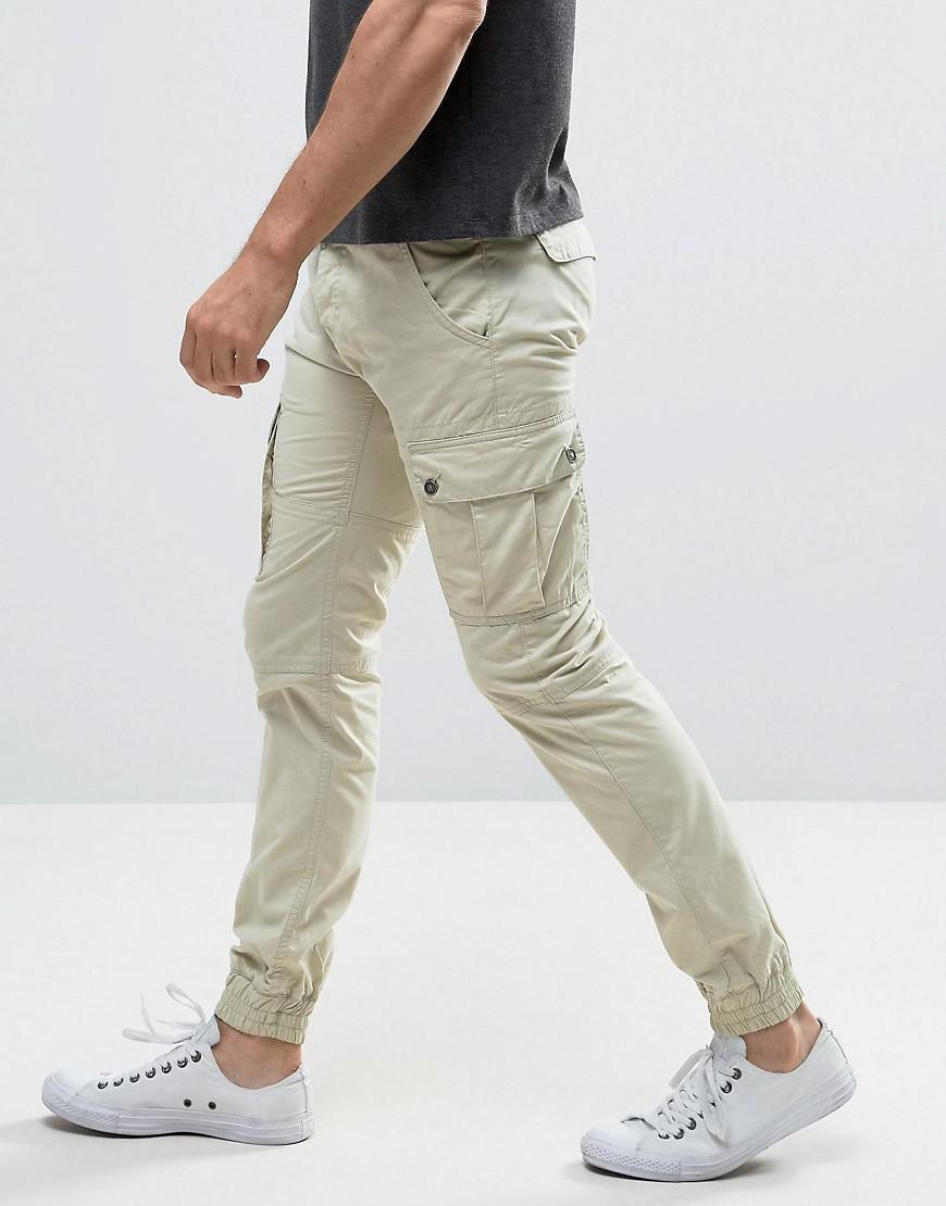 7630baf40bf843 Solid Cuffed Cargo Trousers With Belt for Men - Lyst