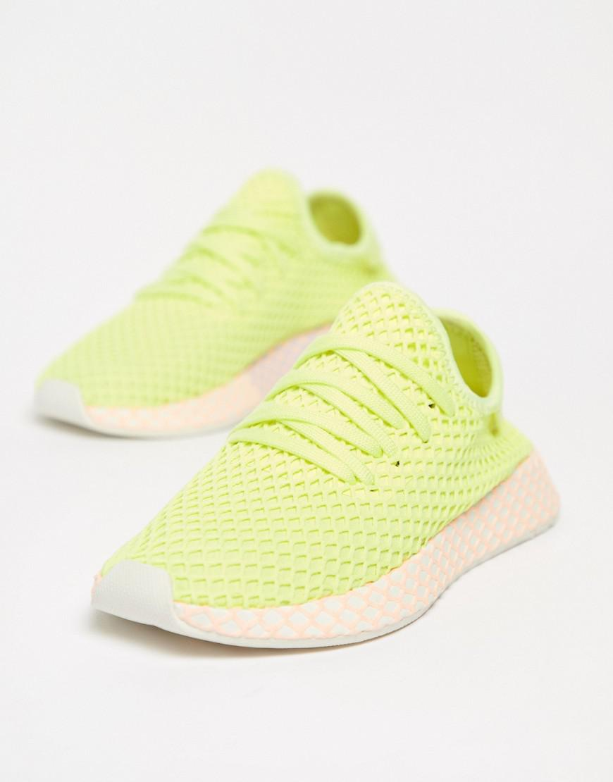 the best attitude 64bc4 d2f3a adidas Originals. Womens Deerupt Sneakers In Yellow And Lilac
