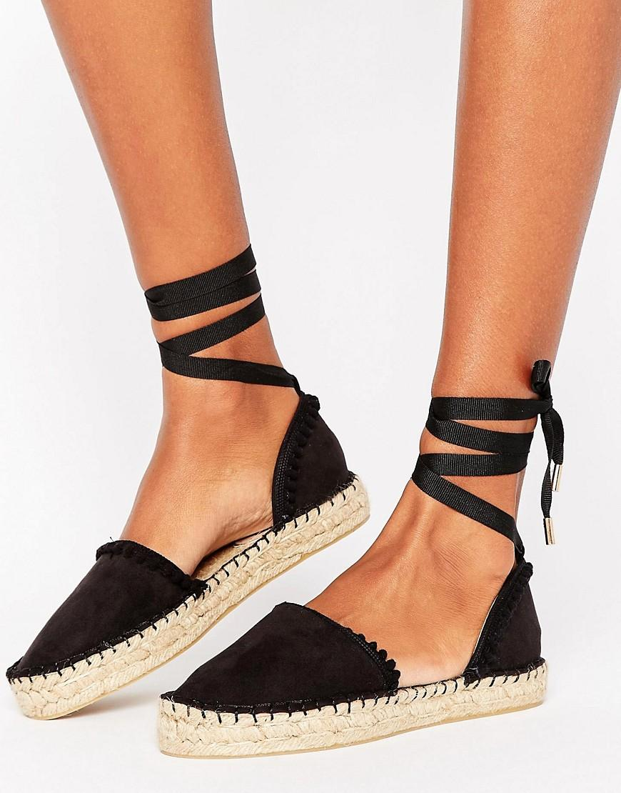 miss kg dizzy pom pom tie up espadrilles in black lyst. Black Bedroom Furniture Sets. Home Design Ideas