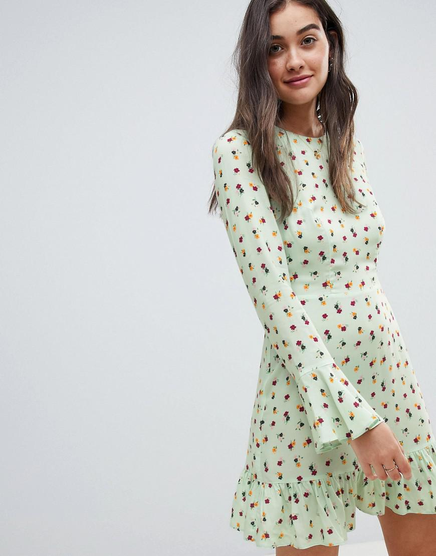 7166f101c9d2 Lyst - ASOS Fluted Long Sleeve Mini Dress With Pep Hem In Ditsy Floral