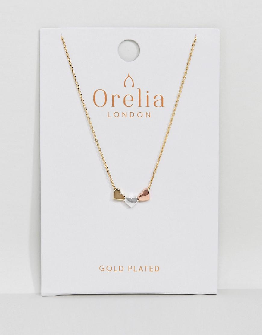 8f89f0e5ca87b Lyst - Orelia Three Little Hearts Necklace in Metallic
