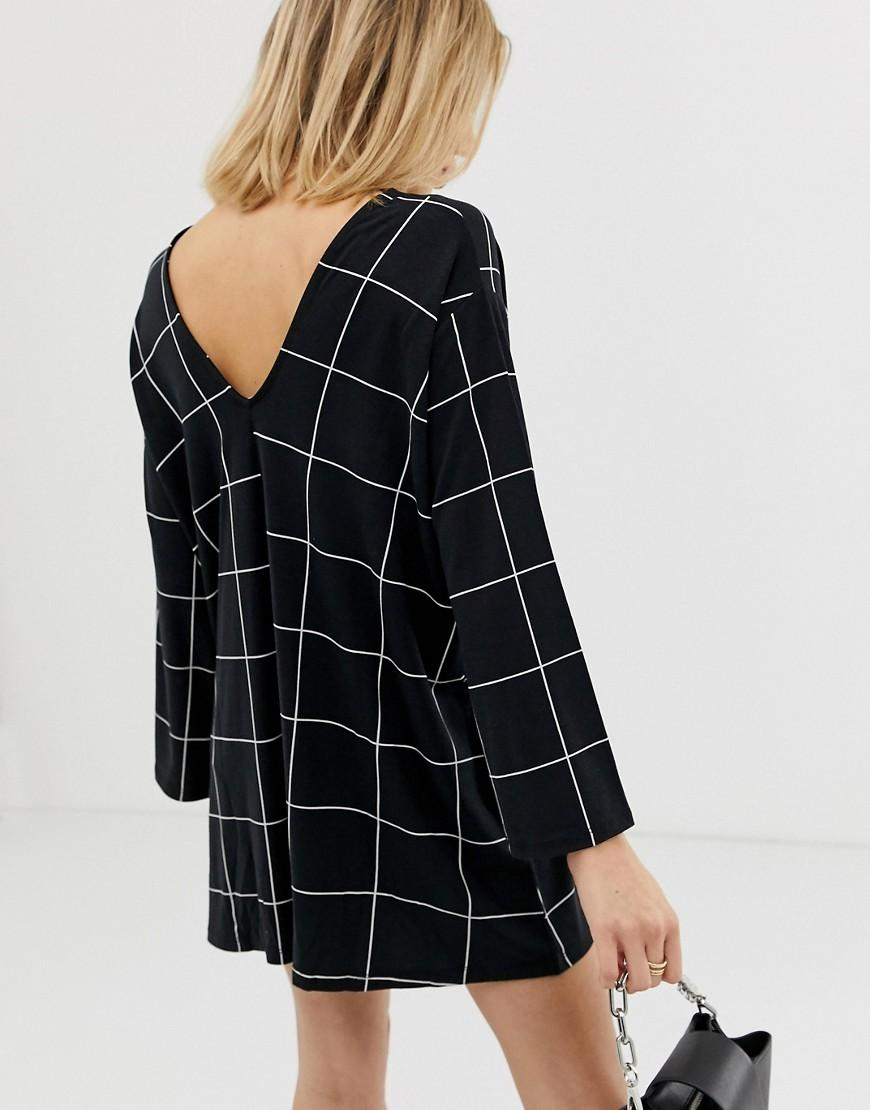 3440ff7ffe Lyst - ASOS Asos Design Petite Swing Playsuit With Fluted Sleeve In Check  Print in Black