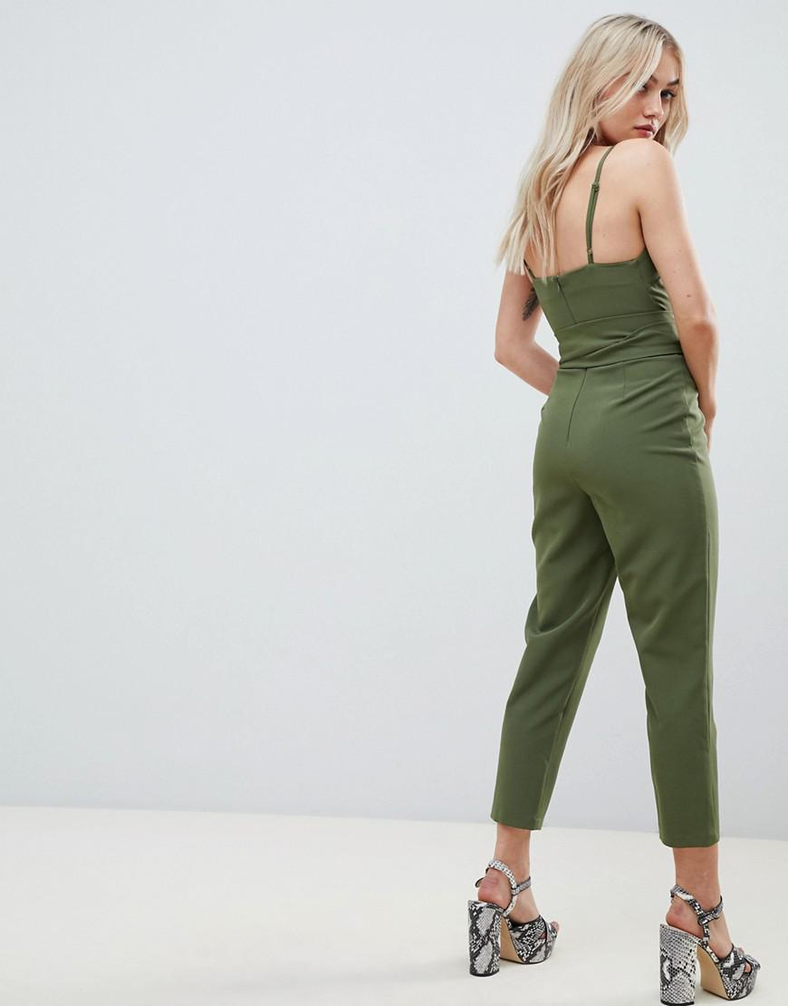 f89a3556b0e Lyst - ASOS Asos Design Petite Wrap Front Jumpsuit With Peg Leg And Self  Belt in Green