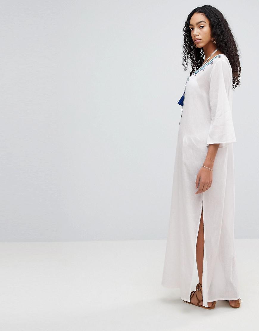 7a81a5b3f9 Lyst - Liquorish Maxi Beach Dress With Embroidered Emblem in White