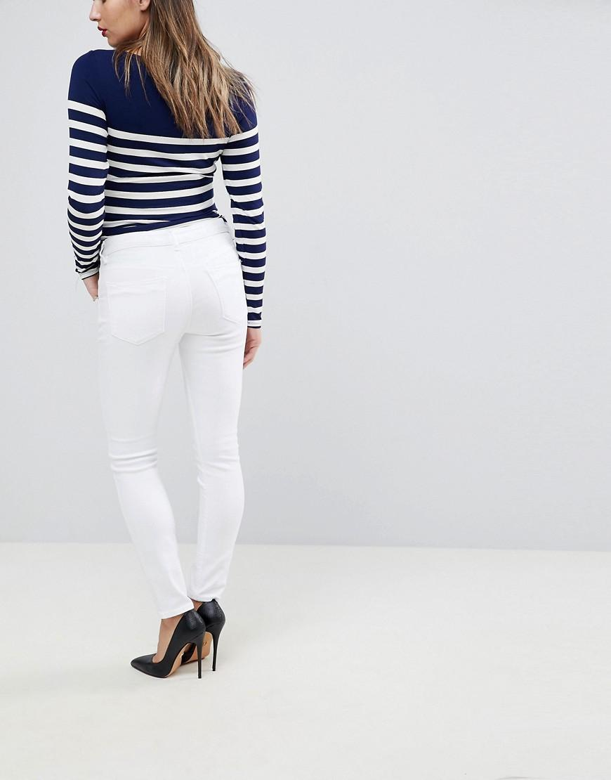 7e3d36b4ce1 Lyst - ASOS Asos Design Maternity Ridley High Waist Skinny Jeans In White  With Under The Bump Waistband in White