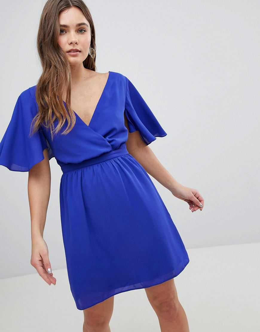 Lyst - ASOS Asos Flutter Sleeve Cross Over Mini Dress in Blue a96073ab2