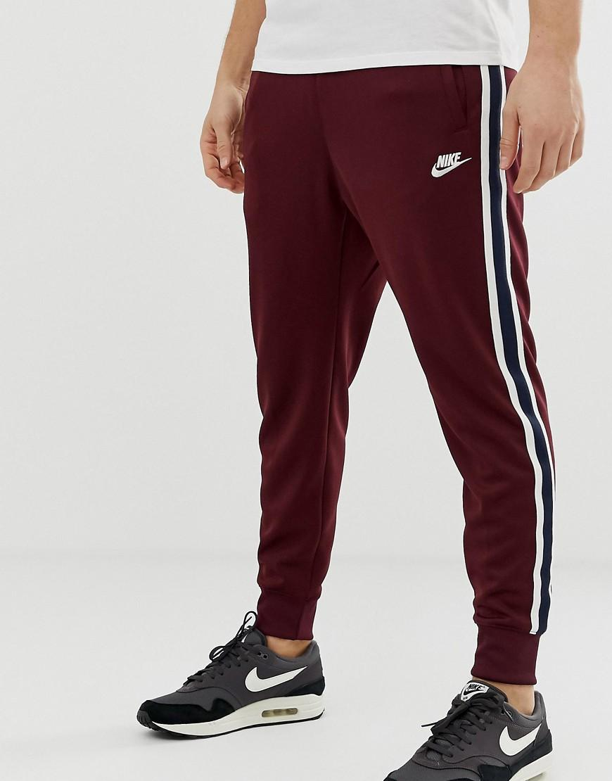 cbb9e727e94b Nike Tribute Track Pants in Red for Men - Save 4% - Lyst