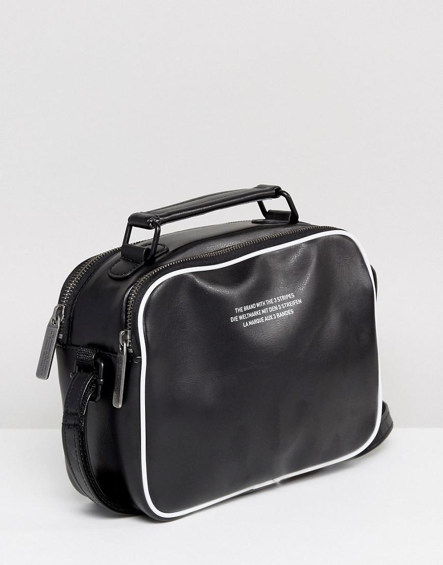 ... Adidas Originals Originals Vintage Mini Airliner Bag In Black in ...  100% quality  Backpacks, Duffel Bags, + Wallets Urban Outfitters ... 0de37dfe39