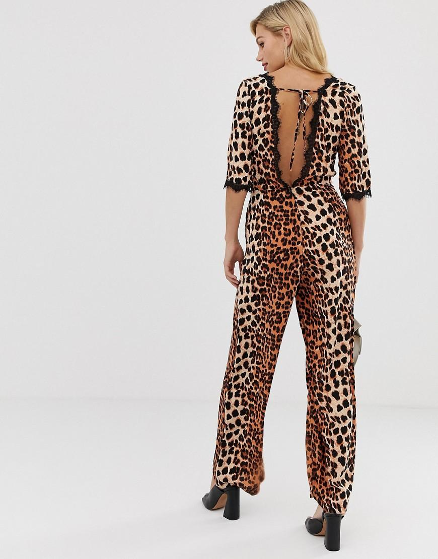 22bf9b14e32a Liquorish Wrap Front Jumpsuit In Leopard Print With Lace Trim Sleeve Detail  - Lyst
