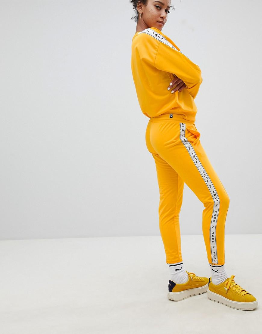 b85aa7254b PUMA Exclusive To Asos Taped Side Stripe Track Pants In Yellow in Yellow -  Save 6% - Lyst